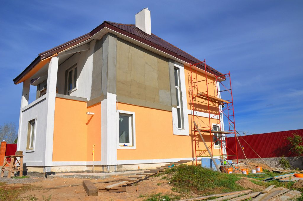 Stucco maintenance to help prepare your home for winter for Exterior house painting in cold weather